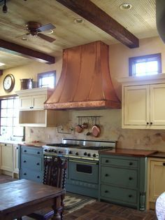 Pictures of some our copper and stainless steel kitchen range hoods. We fabricate wall-mount and island hoods to our customers specifications. Teal Kitchen, Copper Kitchen, Kitchen Paint, Copper Appliances Kitchen, Copper Countertops, Kitchen Countertops, Kitchen Backsplash, Stainless Steel Range Hood, Stainless Steel Kitchen