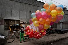 A balloon street vendor yawns while waiting customers outside the Jama Masjid mosque in New Delhi on July 29, 2014. (Bernat Armangue/AP)