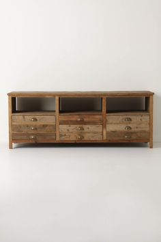 """- Two foldout doors, three drawers, three shelves - Reclaimed pine  - 26""""H, 68""""W, 20""""D - Imported"""