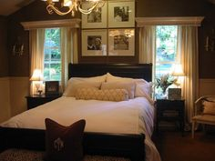 I like the contrast between the dark wall colors and the white bedding. I also love the simple window treatments and the chunky molding over the window. I also love the peak of nature just not the pictures above it
