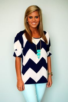 Be nautical this spring in summer in this new chevron top. Model is 53 and is wearing a small.