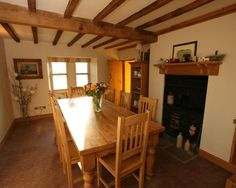 photo of cosy cottagey dining room with exposed beams and cottage