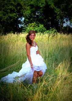 Country wedding dress. Love the simple grass background.