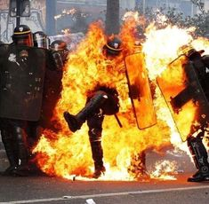 French CRS anti-riot police officers are engulfed in flames as they face protesters during a march for the annual May Day workers' rally in Paris on May / AFP PHOTO / Zakaria ABDELKAFI Soft Grunge, Grunge Style, Post Apocalypse, May Day March, Nirvana, Les Aliens, Riot Police, Punk, World Music