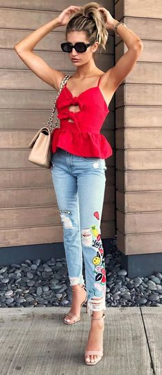 outfit idea: top + printed jeans + bag + heels