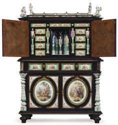 A GERMAN PORCELAIN AND ORMOLU-MOUNTED EBONIZED SIDE CABINET CIRCA 1875, SOME OF THE PORCELAIN PLAQUES WITH IMPRESSED MONOGRAM AND SCEPTRE MARKS FOR BERLIN Estimate USD 15,000 - USD 25,000