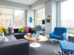 Living room in Chelsea apartment decorated with custom Slab sofa and Saarinen table