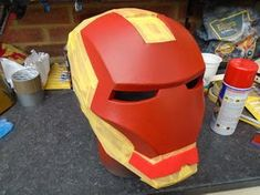 Build an Iron Man Helmet for Cheap!: 10 Steps (with Pictures) Spray Paint Cans, Gold Spray Paint, Red Paint, Iron Man Helmet, 3d Printing Diy, Red Pictures, 3d Puzzles, Foam Crafts, Mascaras
