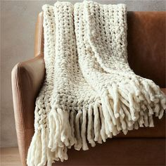 If a sweater designer hung out with a rug designer, this throw would be the result. Love the exaggerated fringe and super-chunky weave. Toss it on a chair for texture or keep it close on the couch for warmth. White Faux Fur Throw, Cable Knit Throw, Sheepskin Throw, Black Pillows, Chunky Blanket, Knitted Blankets, Throw Blankets, My New Room, Designer