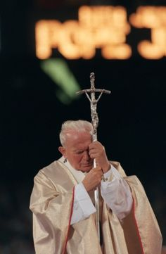 Pope John Paul II leans on his crosier during Mass at Giants Stadium in New Jersey in 1995
