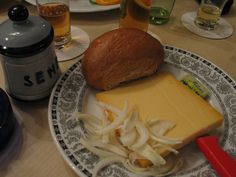 """""""Halver Hahn"""" is the term for a Rhenish rye bread with cheese. The sandwiches (half a rye roll) is usually with butter, a fat middle-aged or two slices of Gouda cheese and served with pickles and mustard, some of them with chopped onions into rings and a pinch of paprika. The court is in the Rhine bars and restaurants is widespread. To the origin of the name (Standard German: half cock) is shrouded in many legends."""