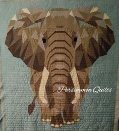 'Elephant Abstractions' quilt made by Katie T. Longarm quilting by Le Ann Weaver of www.persimmonquilts.com