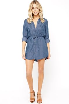 When in doubt, opt for this casual-cool shirt dress. It's made of a lightweight chambray fabric with a soft feel. Features a collar neckline, long cuffed sleeves with optional roll-up button tabs, centerfront button closures, and two chest pockets. Finished with a waist tie detail. #SpringFashion