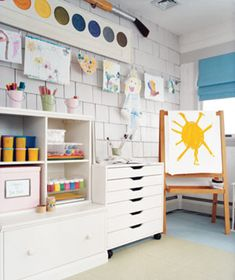 Playroom organization and storage. Adore the brightness with splashes of color plus the oversized paints and brush to personalize the space.