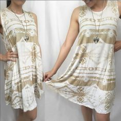 """Taupe and Ivory Tribal Print Flowy Dress MADE IN USA - this adorable sleeveless flowy dress features a taupe colored tribal print all over an Ivory bodice & round neckline. Fits slightly big for a flowy casual fit. S(2-6) M(8-10) L (12-14) Fabric Content: 95% Rayon, 5% Spandex. Apprx 36/37"""" long. Incredibly Soft & lightweight. My already low retail prices are firm unless bundled. Model is 5'2"""" 115 lbs size 2 & wearing small. Slightly big on me but I LOVE it for casual days  Necklace I'm…"""