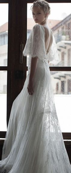 persy bridal spring 2016 half scalloped bell sleeves open back romantic lace wedding dress / http://www.deerpearlflowers.com/wedding-dresses-with-flutter-sleeves/