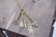 Multi-Amulet Pendant Necklace by WildLivesShop on Etsy