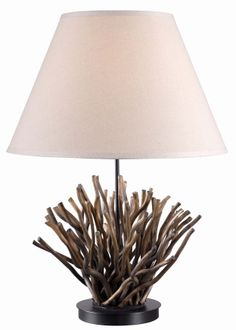 Piper Table Lamp - With the look of coral and the texture of driftwood, Piper evokes the water without gimmicks. Accented with a Taupe Linen shade, it adds a subtly beachy look to a room. #interior #design #nautical
