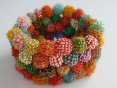 Molecule Bracelet.  Glass seed beads, merino wool, crocheted, magnets.