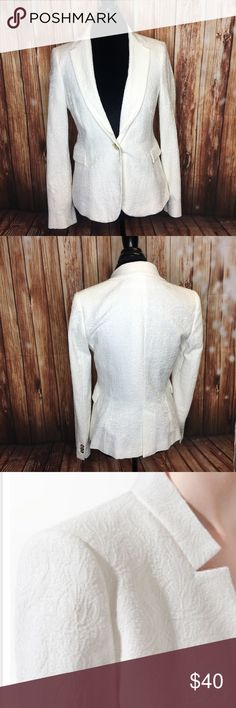 Zara  Jacquard pattern blazer White fitted blazer from Zara with beautiful lace detail. Includes 2 pockets. In great condition; barely worn. 50% cotton, 50% polyester.- Color white  -Like New / With Out Tag - Zara Basic  - Shoulder pads  - Bright colour  - One button in the front  - One slit up the back at the center  - Size Large Zara Jackets & Coats Blazers