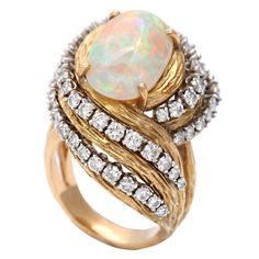 Bombastic Australian Fire Opal Ring with double Swirl of graduated Diamonds. Late 50's - early 60's.