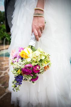 Jessica's bouquet had flowers from each of her bridesmaids' bouquets, creating a colorful and sentimental arrangement. | Real wedding | Austin | Hummingbird house | June wedding | spring | Photo Credit: LewChan Photography www.lewchan.com