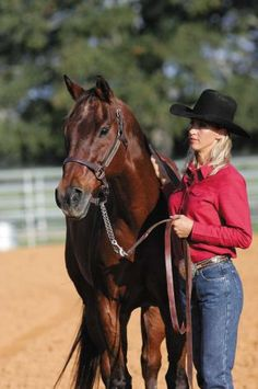 Scamper, who died July 4th, 2012, stands with owner Charmayne James! Great barrel horse!