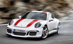 The 911R is just 3021 lbs.  The design of the new 911 R is characterized by a puristic lightweight construction. Unnecessary elements such as the rear seat assembly have been removed. The front lid and fenders have been replaced by lightweight carbon fiber. The roof is made of magnesium. The car is fitted as standard with Porsche Ceramic Composite Brakes. Power is produced by a 4.0 liter naturally-aspirated flat-6 based on the 911 GT3RS with 500 hp. This delivers an impressive…