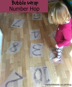 Bubble wrap number hop. Fun way to practice number recognition, counting and simple maths problems as well as added sensory fun of popping bubble wrap with bare feet.