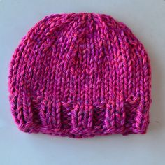 KNIT HAT on size 13 needle ONE SKEIN extra chunky  Cast on 40  K2, P2 for 5 rows  Work stockinette stitch for 9 rows  Decrease row (K4, K2tog) across  P the next row  K the next row  P next row  Decrease row (K2, K2tog) across  P the next row  Decrease next row (K1, K2tog) across  Decrease row (P2tog) across ending with 10sts  cut the yarn, leaving at least 12 to 18 inches. Pull end through the remaining 10sts and pull tightly to close.  Use the mattress stitch to sew the side seam.