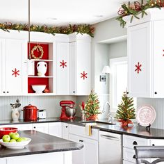Noel Nook    To create a temporary holiday display space, take the door off one cabinet, remove the shelves, and insert a new back panel -- just staple red fabric to cardboard or foam core. Reinstall the shelves to hold the panel in place.