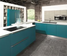 Hacker kitchen in Petrol Blue... Good design has no reason to be shy. This is where the joy of a kitchen is close enough to touch. Not only thanks to the accentuating handles, but also due to the modern, flat extensive colour concept. #hacker #kitchen #design #york