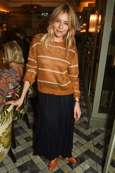 Sienna Miller teamed a casual striped jumper with a pleated skirt for the launch of her sister's bridal collection at the Ivy in Chelsea.