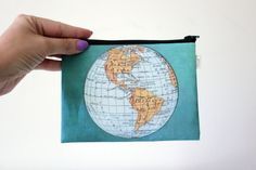 World Map zipper pouch printed with an old map of the by efratul, $15.00