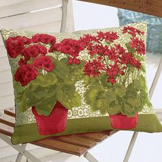 Tapestry cushion decorated with the vibrant blooms of the geranium, a favourite flower across France, particularly suited to the dyer soils of the south.    Cotton/viscose mix with cotton back and feather pad.  47.5cm x 36cm.