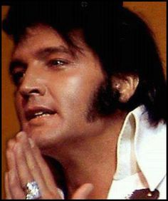 "Elvis says a prayer before going on stage. He was quoted as saying ""He never got over having stage fright""."