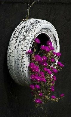 recycled tire as hanging planter...cute!