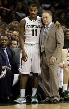 Keith Appling (11) talks to coach Tom Izzo during the second half of MSU's 96-77 win Friday in Brooklyn, N.Y.