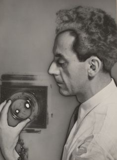 "Man Ray (Emmanuel Radnitzky). Self-Portrait with Camera. 1931. the artist. Gelatin silver print. 6 3/4 x 5"" (17.1 x 12.7 cm). Gift of James Thrall Soby. 104.1941. © 2018 Man Ray Trust / Artists Rights Society (ARS), New York / ADAGP, Paris. Photography"