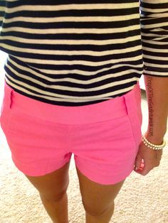 black and white striped shirt with neon pink shorts