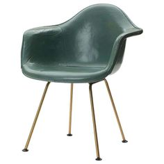 A 'DAX' rope edge fiberglass zenith shell chair designed by Charles & Ray Eames with brass-finished legs retaining the original turquoise green leather upholstery over a matching fiberglass shell. Made by Herman Miller in the USA, circa Vitra Chair, Upholstered Desk Chair, Eames Dining Chair, Arm Chairs, Accent Chairs, High Chairs, Office Chairs, Green Leather Chair, Leather Chairs
