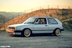 White Volkswagen Golf Mk2 on golden wheels