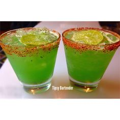 KIWI-RITA  1 1/4 oz. (40ml) Tequila Reposado  1/4 oz. (8 ml) Blue Curaçao  Half of a Kiwi Muddled  1/4 oz. (8 ml) Lime Juice  1/2 oz. (8 ml) Homemade Sweet N Sour  1/4 oz. (8 ml) Agave  Shake with Ice & Strain into a Tajín rimmed Glass.