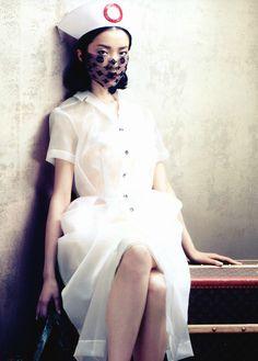 Du Juan in 'Rhapsody of Fashion: The Evolution of Louis Vuitton'    Photographer: Sharif Hamza    Dress,headpiece and mask: Louis Vuitton S/S 2008    Vogue China August 2012