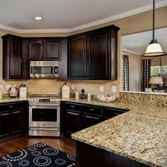 dark cabinets and light granite counter tops