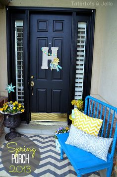 spring porch 2013 tatertotsandjello.com - love this porch! I totally want to do fun things with my porch someday.