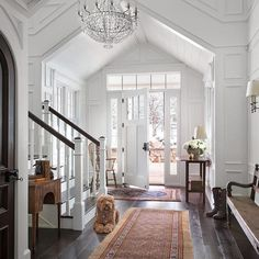 Love the architectural details in this welcoming entry via @archdigest 📷@emredfield • • • • #entrance #entry #architecture #architectural #orientalrugs #bench #blackdoor #whitepaint #chandelier #interiordesign #interiors #interiorstyling