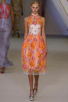 In love with this  dress' vibrancy in orange and purple while separating the the dress at the bodice with a simple elegant cream silk piece with detailing in orange flowers.   By designer Erdem at London fashion week for Spring 2013 RTW