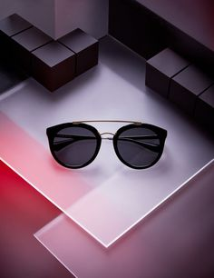 Still life photography of Prada sunglasses by London based advertising photographer Josh Caudwell. Creative photography with a Bladerunner inspired set design. Futuristic modern dystopian editorial shot for GT Magazine.