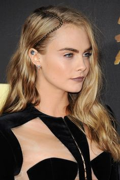 Cara has made few red-carpet appearances so far this year, so it was no surprise that the Vogue cover girl pulled out all the stops for this one. While her signature golden locks were kept in a side parting, she updated the look with a dainty plait running through her parting. When it came to beauty, Cara kept her skin dewy and golden while her lips were painted in a matt mauve shade. Eyebrows were as perfect as ever. Browse the full MTV awards gallery on Miss Vogue.